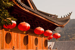 Chinese lanterns in a temple. Red lanterns hanging on the temple roof Royalty Free Stock Photos