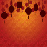 Chinese lanterns on traditional wallpaper. Hanging Asian lanterns on traditional Chinese wallpaper with space for text Royalty Free Stock Photos