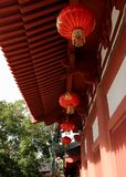 Chinese lanterns under wooden roof royalty free stock photo