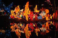 Chinese lanterns on water. Traditional Chinese lanterns and reflections on the river. This is taken in Jiangyou park, Sichuan, China Royalty Free Stock Photo