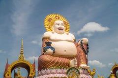 Chinese Laughing Buddha at Plai Laem Temple - Main Symbol and Popular Landmark of Samui Island in Thailand. Tourism and royalty free stock image