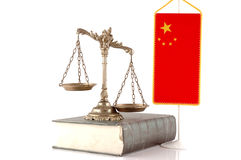 Chinese Law and Order. Decorative Scales of Justice on the book with Chinese flag on white. Law and order concept Stock Images