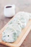 Chinese leek steamed dessert on wooden table Royalty Free Stock Photo