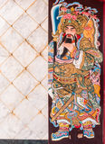 Chinese legend of the god's painting on wooden door. Chinese legend of the god's painting on wooden door and marble wall Stock Image