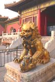 Chinese lion with his child stock photos