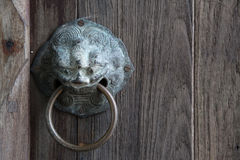 Chinese lion knob. Knocker wood door Stock Images