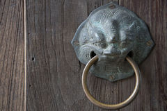 Chinese lion knob. On wooden door Stock Photography