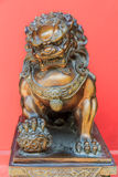 Chinese lion sculpture. Bronze Chinese lion sculpture, male of the pair, holding a ball, representing the world in his front paw, symbol of protection and power Stock Images