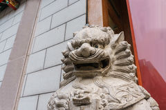 Chinese lion sculpture. Chinese lion statue sculpture before door Royalty Free Stock Images