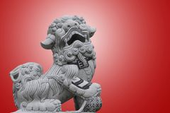 Chinese lion statue. Chinese dragon statue sculpture on red background Royalty Free Stock Photos