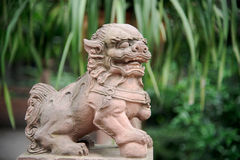 Chinese lion statue. Male lion guard holding a ball in China Royalty Free Stock Photography