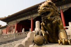 The Chinese lion statue. Guarding an entrance to the Forbidden City in China Stock Image