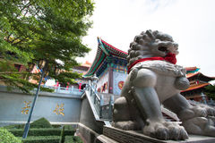 Chinese lion statue in the Buddhist temple. Royalty Free Stock Images