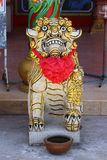 Chinese lion statue with red ribbon in the Chinese Shrine Stock Photography