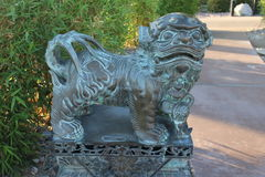 Chinese Lion. Statue set up in a garden Stock Photos