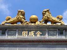 Chinese Lions with old coins. On the roof Stock Photo