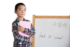 A Chinese little boy in the back to school for the new term Stock Photo