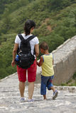 A Chinese little boy hiking with mom hand in hand, on the Great Wall Royalty Free Stock Photo