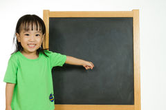 Chinese little girl with blank blackboard Royalty Free Stock Image