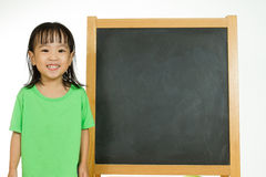 Chinese little girl with blank blackboard Stock Photography