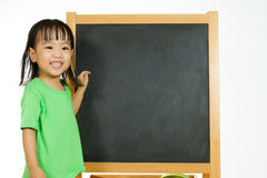 Chinese little girl with blank blackboard Stock Image