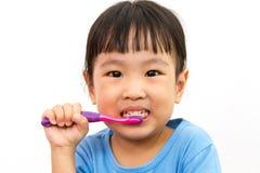 Chinese little girl brushing teeth Stock Images