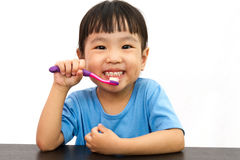 Chinese little girl brushing teeth Royalty Free Stock Photo