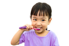 Chinese little girl brushing teeth Royalty Free Stock Photography