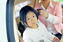 Chinese little girl in car Royalty Free Stock Image
