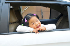 Chinese little girl in car Stock Photography