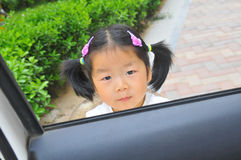 Chinese little girl in car Stock Photos