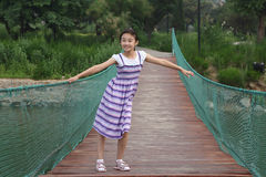 Chinese little girl on hanging bridge Royalty Free Stock Photo