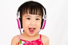 Chinese little girl on headphones Stock Photography