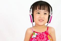 Chinese little girl on headphones Stock Photo
