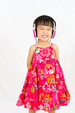 Chinese little girl on headphones Stock Images
