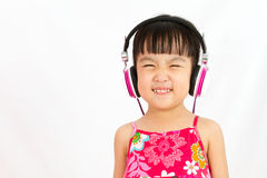 Chinese little girl on headphones Stock Photography