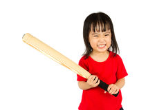 Chinese little girl holding baseball bat with angry expression. Portrait of a young little Chinese girl holding baseball bat with angry expression in white Royalty Free Stock Image