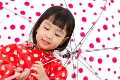 Chinese Little Girl Holding umbrella with raincoat Royalty Free Stock Photos