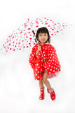 Chinese Little Girl Holding umbrella with raincoat Royalty Free Stock Photography