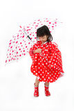 Chinese Little Girl Holding umbrella with raincoat Stock Photography