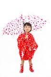 Chinese Little Girl Holding umbrella with raincoat Stock Photo