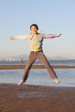 Chinese little girl jump Royalty Free Stock Photography