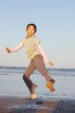 Chinese little girl jump Stock Photo