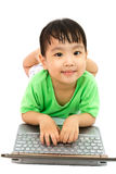 Chinese little girl lying down with laptop Stock Photos