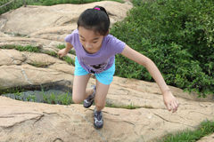 Chinese little girl in mountain climbing Royalty Free Stock Images