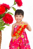 Chinese little girl pising holding  Spring festival couplets Royalty Free Stock Photo