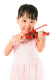 Chinese Little Girl Playing Violin Royalty Free Stock Photography