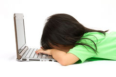 Chinese little girl sleep in front of a laptop Royalty Free Stock Image