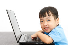 Chinese little girl using laptop Royalty Free Stock Image