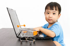 Chinese little girl using laptop Royalty Free Stock Images